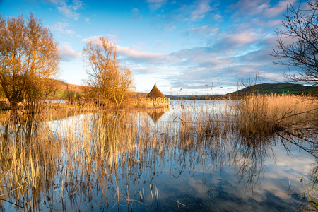 brecon beacons: A Welsh Crannog on Langorse Lake in the Brecon Beacons