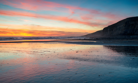 Sunset over the beach at Dunraven Bay near Bridgend in Wales