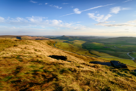 Late evening sunlight from the top of Shining Tor between Buxton and Macclesfield in the Peak District in Cheshire, with the peak of Shutlingsloe in the center distance Stock Photo