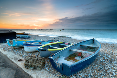 Boats on the shingle beach at Selsey near Chichester on the West Sussex coast