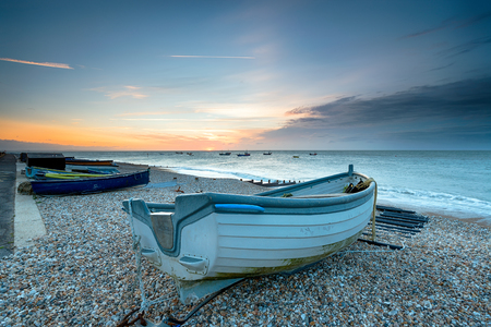 Boats on the beach at sunrise at Selsey in West Sussex
