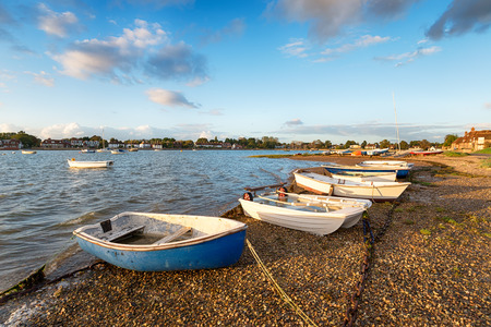 Boats on the shore at Bosham harbour near Chichester in Sussex