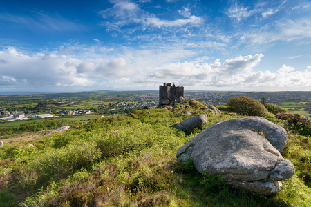 Carn Brea Castle, a former hunting lodge perched high above the town of redruth in Cornwall Stock Photo