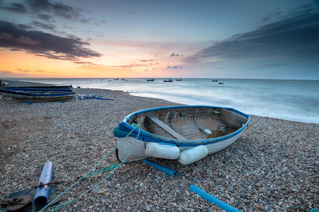Stunning sunrise over fishing boats on the beach at Selsey Bill on the West Sussex coast