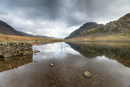 The shores of Llyn Idwal lake in the Glyderau Mountains in Snowdonia National park in Wales