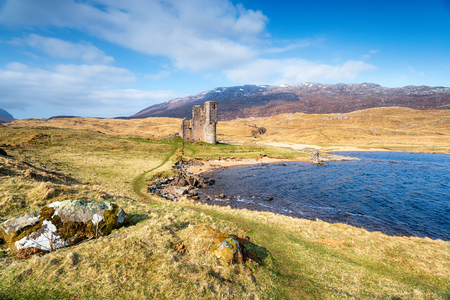 The ruins of Ardvreck Castle on the shores of Loch Assynt in Sutherland in the Scottish Highlands and part of the NC500 tourist route
