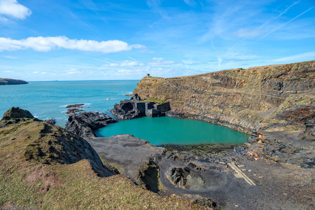 The Blue Pool at Abereiddy on the Pmebrokeshire coast in Wales Фото со стока
