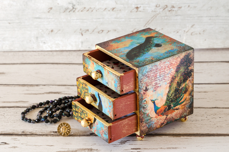Beautiful decoupaged peacock jewlelery chest with drawers