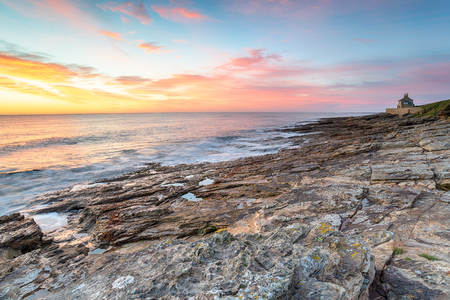 Beautiful sunrise over the beach at Howick on the rugged Northumberland coastline
