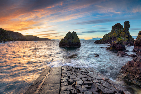Sunset at the old jetty at Pettico Wick Bay on St Abbs Head near Eyemouth in the Scottish Borders