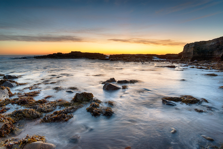 Sunrise over the beach at Howick on the rugged coast of Northumberland