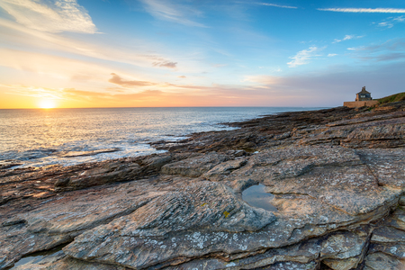 Beautiful sunrise over the sea at Howick on the Northumberland coast Stock Photo