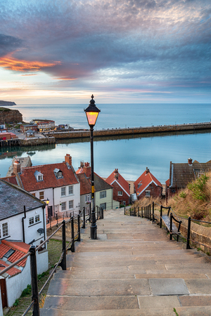 Night falls over Whitby on the North Yorkshire coast, from the 199 Steps leading down to the harbour