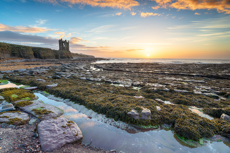 Sunrise over the ruins of Keiss castle on the north east coast of Scotland
