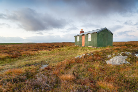An old hut on moorland near Stornoway on the Isle of Lewis in the Western Isles of Scotland Фото со стока