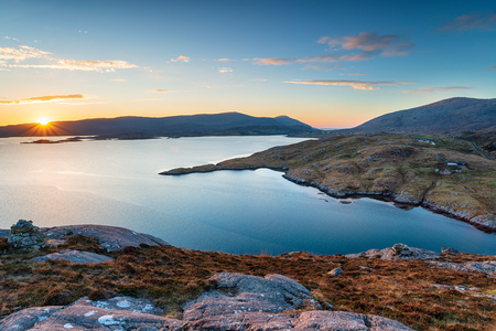 Sunset over the Isle of Harris coastline from Urgha and looking out to Tarbet