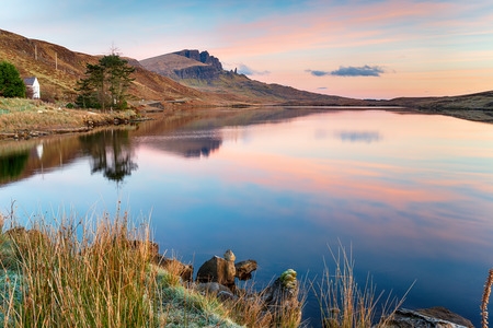 Beautiful sunrise over Loch Fada on the Isle of Skye with the Old Man of Storr in the distance