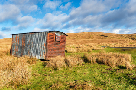 An old railway goods carriage now used a shelter on the Penine Way on Tan Hill in the Yorkshire Dales
