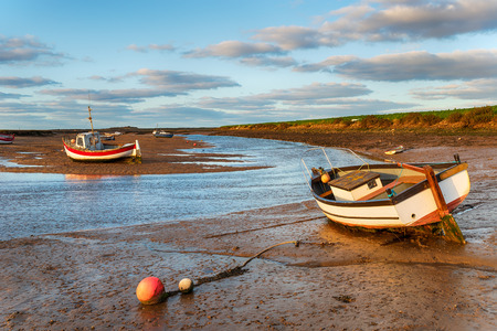 Boats at the quay side at Burnham Overy Staithe on the Norfolk coast Reklamní fotografie