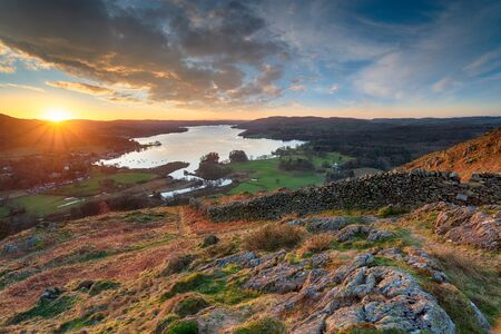 Sunrise over Windermere in the Lake District National Park from Loughrigg Fell Stock Photo