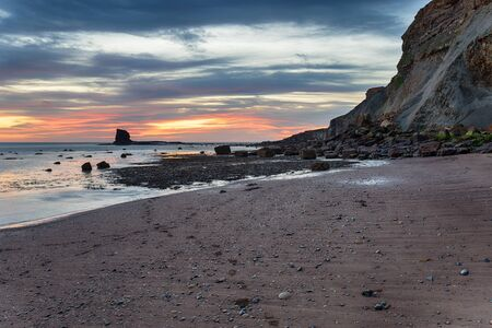 Sunrise at Saltwick Bay on the North Yorkshire coast near Whitby