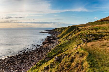 Grassy cliffs at Stoer Head near Lochinver in the Highlands of Scotland