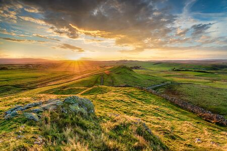 Sunset over Hadrians Wall from Caw Gap near Haltwhistle in Northumberland