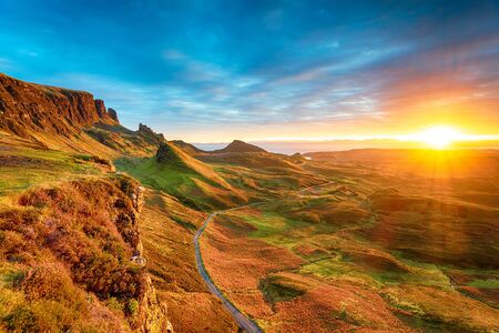 Magical Autumnal sunrise over the Quiraing rock formations caused by an ancient landslip on the Isle of Skye in Scotland Stock Photo