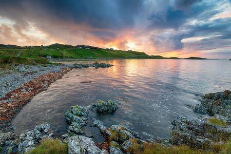 Stormy sunset sky over the rugged beach at Scourie on the Sutherland coast of Scotland Imagens