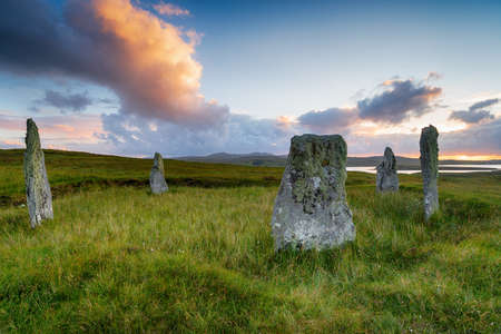 Summer sunset over Ceann Hulavig stone circle, also called Callanish 4, on the Isle of Lewis in the Outer Hebrides of Scotland Stock fotó