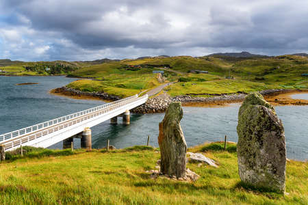 The bridge over the Atlantic and the standing stones of Callanish VIII on Great Bernera, a small island off the Isle of Lewis in the Outer Hebrides of Scotland