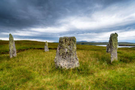 Dramatic sky over Ceann Hulavig or the Callanish IV Stone Circle on the Isle of Lewis in the Outer Hebrides of Scotland