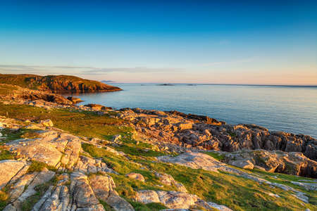 Sunset ove the coastline at Huisinis on the Isle of Harris in the Outer Hebrides of Scotland