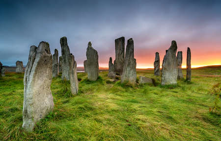Stormy sunset over the Callanish Stones on the Isle of Lewis in the Outer Hebrides of Scotland