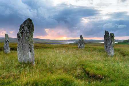 Sunset over the Callanish IV stone circle also known as Ceann Hulavig, on the Isle of Lewis in the Western Isles of Scotland
