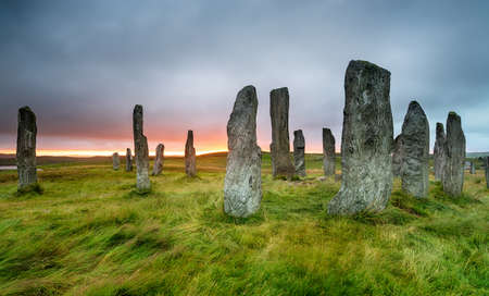 Moody sunset over the Callanish Standing Stones on the Ilse of Lewis in the Western isles of Scotland