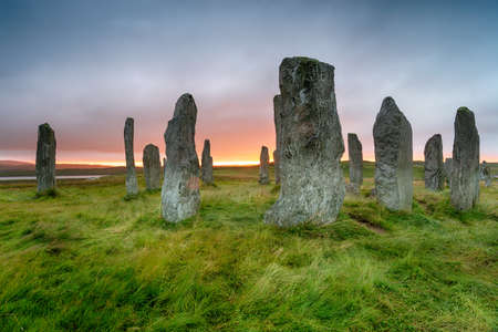 Stormy sunset over the Callanish Stones on the Isle of Lewis in the Western Isles of Scotland
