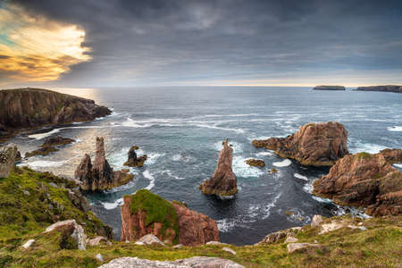 Brooding sky over the sea stacks at Mangersta on the Isle of Lewis in the Western isles of Scotland Stock fotó