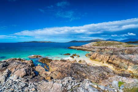 Beautiful rugged coastline under a deep blue sky on the Isle of Harris at Traigh Seilebost beach
