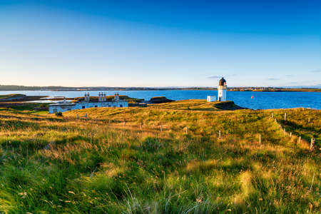 Summer evening at the lighthouse at Arnish Point overlooking Stornoway harbour on the Isle of Lewis in the Outer Hebrides of Scotland