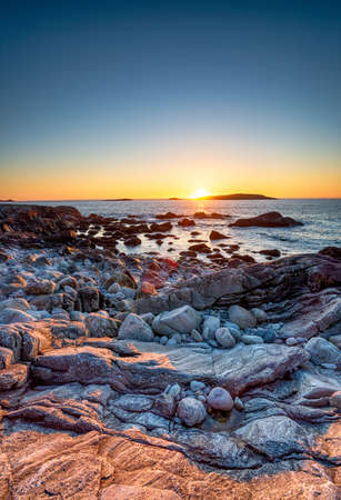 Sunset over the rocky beach at Mealista on the Isle of Lewis in the Outer Hebrides of Scotland
