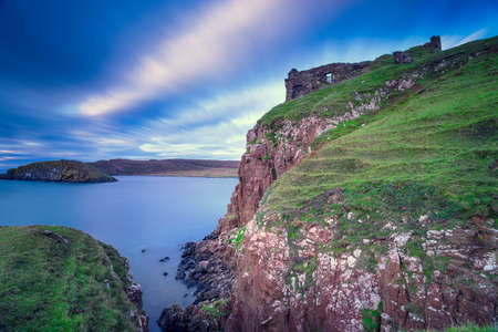 The humble remains of Duntulm Castle perched on cliffs on the Isle of Skye in Scotland