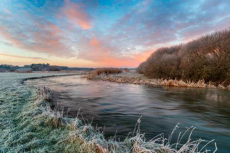 A frosty winter sunrise over the river Frome at Holmebridge between Wool and Wareham in the Dorset countryside