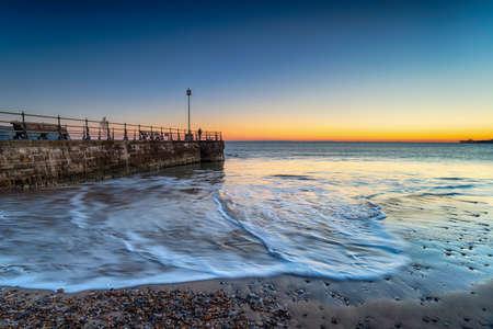 Sunrise over the beach at Swanage on the Dorset coast
