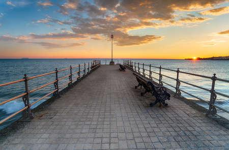 Stunning sunrise over the Banjo Pier at Swanage on the Dorset coastline