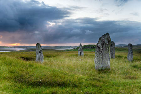 Stormy skies over the Callinish 4 stone circle on the Isle of Lewis in the Outer Hebrides of Scotland