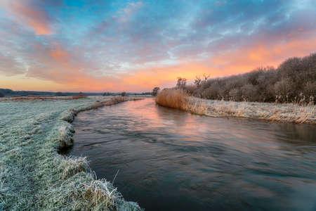 Dramatic winter sunrise over the river Frome at Holmebridge near Wareham in Dorset