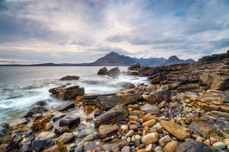 Dramatic skies and mountains from the beach at Elgol on the Isle of Skye in Scotland