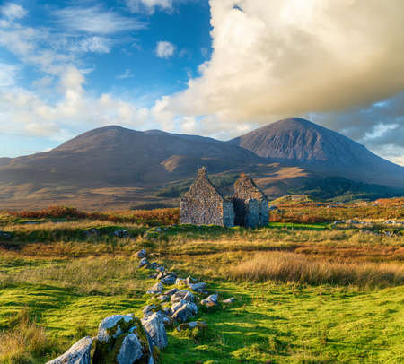 The ruins of the old Manse nestled under the Beinn na Caillich mountain at Killchrist near Broadford on the Isle of Skye in Scotland