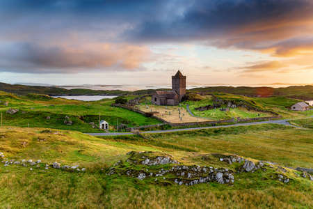 Moody sunset over the old church at Rodel on the Isle of Harris in the Outer Hebrides of Scotland